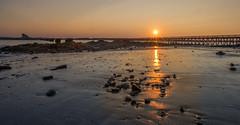 Fort Foster - last light of the day... (jamesmerecki) Tags: sunset dawn lastlight sunsetting sundown kitterypoint maine me seacoast pier reflection lowtide fort fortfoster seascape beach rays