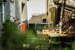 This is Your Hometown (*Capture the Moment*) Tags: 2016 bern berne bokeh farbdominanz fotowalk furniture huserwohnungen mbel restaurant schweiz sommer sonne sonya7ii summer sun switzerland wetter zeissbatis1885 bokehlicious green grn red rot