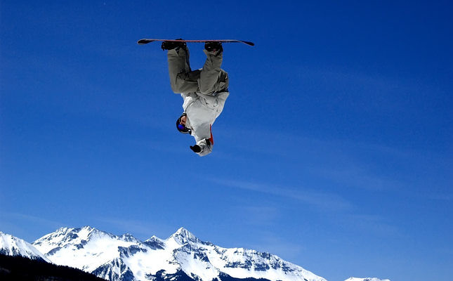 Snowboarder jumping during a competition