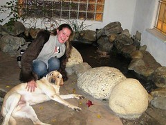 Vanessa Aubert and Herky enjoy a moment by the Koi