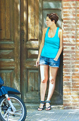 Short hair (chrisk8800) Tags: barcelona street city portrait people urban woman girl face lady female lumix nice model pretty legs sandals cigarette candid smoke young streetphotography streetlife smoking panasonic jeans attractive denim shorts brunette tobacco appealing minishorts mini street photography hair fz150 short shorts