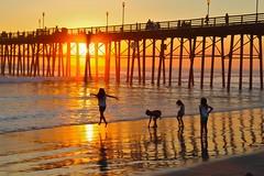 sun and sea (Karol Franks) Tags: beach sun sand reflection pier sunset girls orange ocean dance oceanside ca silhouette glee socal jump fun sea sky karolfranksgmailcom ©2014 karolfranks ©karolfranks okarolyahoocom
