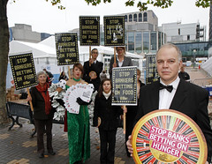 Food Speculation: Lady Luck at Conservative Party Conference (Global Justice Now) Tags: world party england food price movement birmingham protest conference conservative development tory banking commodity prices speculation bankers wdm