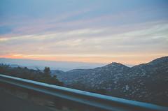 DR STILL (ELMUNDOPORMISOJOS) Tags: california street sunset sky mountains clouds landscape julian driving sandiego pastel horizon rail boulders socal railing