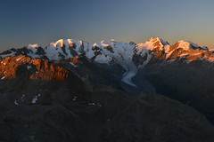 The Bernina group at sunrise (echumachenco) Tags: pizlanguard georgyhtte berninagruppe alps mountain outdoor sunrise morning dawn light shadow view panorama ridge summit arte ice snow glacier pink orange sky blue rock pizpal pizbernina bellavista pizcambrena pizmorteratsch morteratschgletscher engadin pontresina grisons graubnden switzerland schweiz suisse suiza svizzera nikond3100 landscape
