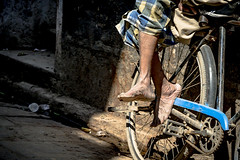 Streets of Varanasi, India (nicklaborde) Tags: 500px bike wheel road people adult man biker street feet india varanasi wear cyclist one outdoors travel