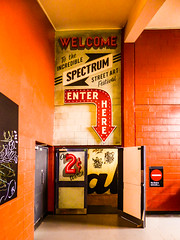Welcome to the Incredible (Steve Taylor (Photography)) Tags: welcome incredible spectrum streetart festival enterhere 2cworth ymca noentry art graffiti mural sign tag stencil door orange black yellow brown newzealand nz southisland canterbury christchurch city arrow