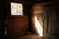 the bull's pen (oldogs) Tags: farm ranch antique vintage barn wood window walkerranch t6s light
