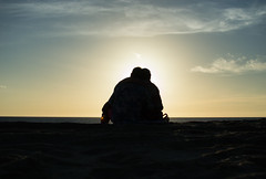 Silhouetted Couple (thanatosst) Tags: sunset beach silhouette couple hugs love sweet paradise