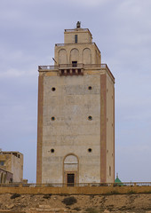 The old lighthouse of Benghazi, Libya (Eric Lafforgue) Tags: africa color building vertical architecture outdoors italia northafrica colonial nobody nopeople libya berenice benghazi libia libye libyen colorpicture lbia europeanquarter italiancolony cyrenaica libi libiya  ribia liviya libija colourpicture       lbija  lby  libja lbya liiba livi  a0014773