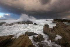 Stormin' (pominoz) Tags: sea storm clouds rocks waves dusk nsw chalkybeach