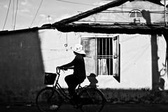 daydreaming in slow-mo [explore] (MdKiStLeR) Tags: street light shadow urban bw lines contrast southeastasia candid an vietnam hoi 2012 urbanx mdkistler icouldhavestayedinthisspotfordays daydreaminginslowmo