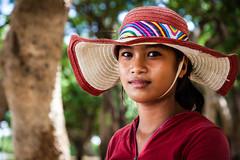 49/100 Sreynun - Villager, Kompong Phluk, Cambodia (Benicio Murray) Tags: travel portrait girl beautiful hat female canon fishing cambodia village strangers 100 siemreap 5dmk2 flickrtravelaward