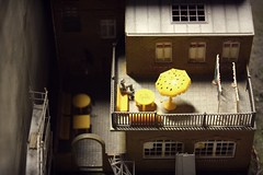 Waiting (ms holmes) Tags: lighting man building berlin hat yellow umbrella licht miniature construction klein waiting mood little details small atmosphere sunshade hut gelb mann gebude atmosphre figur stimmung warten schirm sonnenschirm baugerst winzig loxx miniaturwelten canoneos1000d