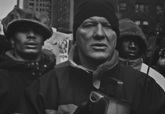February 2002 Rally Against the Iraq War - New York City (ChrisGoldNY) Tags: city nyc newyorkcity 2002 winter people urban blackandwhite bw men history portraits radio three forsale manhattan candid antiwar posters gothamist antibush protests bookcovers albumcovers chrisgoldny chrisgold chrisgoldphoto chrisgoldphotos