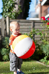 Dont even think about touching my beach ball, ok? (s0ulsurfing) Tags: boy portrait baby cute face backlight canon garden fun 50mm eyes toddler infant babies play faces head expression availablelight ambientlight priceless innocent expressions adorable sunny ears william isleofwight 7d innocence ambient backlit mischievous relaxed infants oneyearold beachball minime 2012 fofinho thelook totland s0ulsurfing familyuk gettyimagesportraits