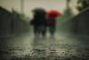 Red Umbrella (Jonathan Kos-Read) Tags: china bridge storm rain beijing raindrops dxo choice puddles wetground redumbrella 135mmf2dc 135mmf2ddc iceboxcool unanicool nikkor135mmaff2dc