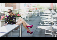 Tatyana G. (Justin Wolfe) Tags: street city flowers portrait urban woman sunlight hot building cute sexy film philadelphia glass colors girl beautiful sunglasses skyline architecture female canon vintage movie table skinny outside 50mm glasses chair women soft downtown dof natural legs bokeh terrace balcony seat grain hipster magenta streetphotography sunny lookout retro pa heels classical philly hip grainy 18 overlook cinematic illuminate urbanphotography urbansetting philadelphialight hallbroad phillylight