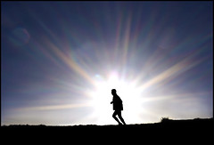 The Marathon Runner (adrians_art) Tags: people sports athletics marathon silhouettes bluesky running sportsman sprinter sunbursts