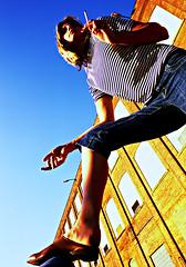 Sandra Blue Sky 10 (neohypofilms) Tags: blue light portrait sky woman color slr film colors girl shirt lady female 35mm vintage nikon long colours legs cigarette stripes 28mm retro smoking bleu photograph blonde 70s clogs heels series 1970s trippy smoker leak mules slipper fm2