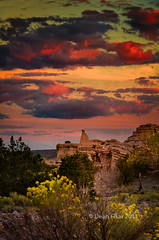 Sunset at White Place [Explored 9/30/2012] (dfikar) Tags: flowers sunset newmexico crimson yellow clouds twilight sandstone unitedstates explore getty yellowflowers abiquiu whitepoint lateafternoonlight colorfulsky whiteplace highdesertlight
