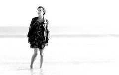 (Nathan O'Nions) Tags: ocean sea portrait blackandwhite white seascape black hot cold beach water female canon pose hair landscape warm dress wind horizon over windy blowing rule jackets exposed thirds ruleofthirds 500d blackandwhiteportrait
