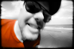 Portraited orange T-shirt. (CWhatPhotos) Tags: pictures portrait orange sun holiday color colour beach face del out that glasses photo blurry focus with image artistic photos pics picture tshirt selection blurred playa pic images shades part photographs photograph coloring ingles which has colouring contain select partial containing cwhatphotos pjotograph