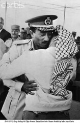 U1806971 (ngao5) Tags: africa people men army clothing hugging president headscarf egypt middleeast males prominentpersons government leader adults armedforces interaction palestinians yasserarafat africans arabs headgear kaffiyeh egyptians anwarsadat traditionalclothing middleeasterners 2andgroup headcloth nationalgovernment governmentofficial politicalleader northafricans chairmen armaround arabrepublicofegypt ismailia palestineliberationorganization alismailiyahgovernorate