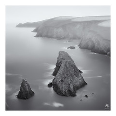 Nohoval Cove (fearghal breathnach) Tags: nohovalcove kinsale oysterhaven seastack seastacks rocks seascape monochrome mono blackwhite bw longexposure calm fog mist squareformat square border sea mood cliffs ireland cork westcork 5d eos5d canoneos5dmarkiii ef1635mmf4lisusm wideangle ultrawide water stillness athmosphere