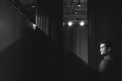 In exhibition (TAHUSA) Tags: ricoh gr gr1 digital pointandshoot camera snapshot snap exhibition hongkong taikoo bw blackandwhite vscopreset portrait man lighting geometry 18mm f28 wide open 28