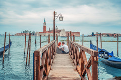 A gesture of love (tianshuliu) Tags: italy love youth venice rain water waterfront moment green cloudy mood warmth travel