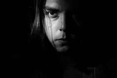 me. (GogyJen.L) Tags: lowlight low key bw portrait face people me playing hair serious
