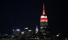 The Empire State Building is lit red and white in honor of the New York Philharmonic Opening Gala. (apardavila) Tags: chryslerbuilding empirestatebuilding hoboken manhattan newyorkcity nyc skyline skyscraper