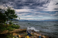 The Chair Against The Waves (Alfred Grupstra Photography (bussy until 30 octobe) Tags: lakeohrid chair clouds lake trees waves buqez qarkuikors albani al