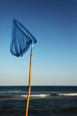BLU (Wael Massalkhi) Tags: blue trees sea test brown holiday net beach water canon sand rocks waves wind olympus clean greece footsteps tough rhodos tsambika tsampika