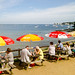 Holidaymakers enjoy a view of Studland Bay in Dorset  from the cafe on Middle Beach
