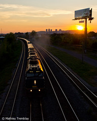 VIA 14 @ Saint-Lambert (Mathieu Tremblay) Tags: ocean railroad sunset train soleil montreal 14 coucher rail billboard via halifax chemin fer enseigne