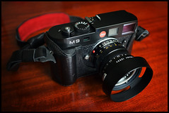 The Dark Knight Rises (*monz*) Tags: leica wood red black rome leather digital 35mm canon table 50mm f14 rangefinder case german hood luigi summilux m9 reddot cs3 leitz solms monz f14l crescenzi 5dmk2 leicatimes