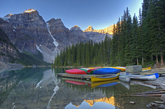 Paradisiacal (dbushue) Tags: morning lake snow mountains nature reflections landscape dock nikon scenery peaceful calm canoes glaciers serene peaks tranquil kayaks 2012 banffnationalpark morainelake valleyofthetenpeaks coth supershot paradisiacal absolutelystunnings