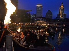 WaterFire volunteer Carrie Capizzano receives the flame to lite WaterFire on her wedding day!