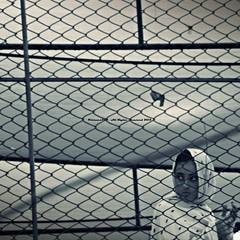 The Girl Behind The Fence (Fortunes2011.Toy Heart) Tags: woman girl freedom nikon free locked 黑色和白色 سیاهوسفید blackandwhitebwmonochrome photoscape أبيضوأسود girlbehindfence womanbehindfence nikoncoolpixl120 fortunes2011 portraitmonochromebwfaceeyesexpressioncloseuplookmodelgirlyouth womaninchainswomanbehindfencefencebarscageimprisonedinprisonfencedcagedbirdfree macropixcom