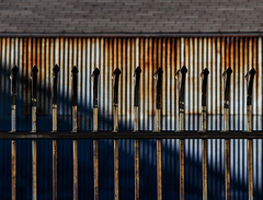 well-protected rust & blues (MyArtistSoul) Tags: ca blue shadow urban abstract texture lines wall fence losangeles rust iron decay steel minimal diagonal spikes corrugated artsdistrict 70200mmf4 zeni 0943