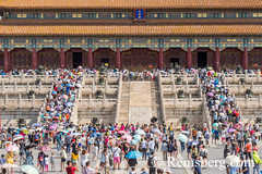 Beijing China - Tourists walking and taking pictures as they enter the Palace Museum located in the Forbidden City. (Remsberg Photos) Tags: asia beijing eastasia china forbiddencity emporer dynasty ming tourists sightseeing palacemuseum history historical culture chineseculture forbidden traveldestinations internationallandmark architecture cityscape temple tiananmensquare monument meridiangate umbrellas sunny chn
