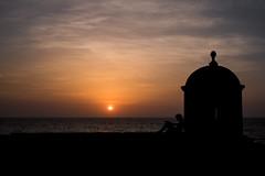 Sunset in Cartagena (lvpz) Tags: himmel sky outdoor sonnenuntergang sunset landschaft wolken clouds wolke kste coast ufer palmen palmtrees ocean caribic road cartagena colombia chilling view wall