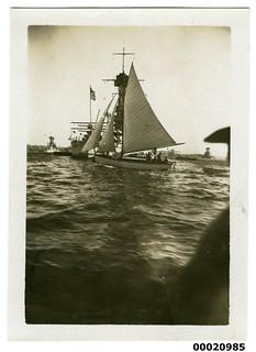 Sailing boat with United States Navy battleshi...