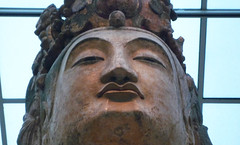 Bodhisattva, probably Avalokiteshvara (Guanyin), with detail of face from below