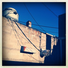 (Joie de Vivre) Tags: blue shadow sky wall vent wire rust iphone hipstamatic