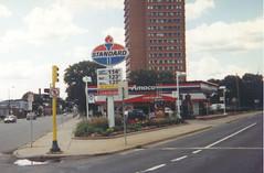 Standard station, Minneapolis, 1999 (STUDIOZ7) Tags: minnesota shell minneapolis automotive gasstation oil service roadside gasoline mn gasprices nineties 1990s amoco standardoil petroliana americanoil certicare