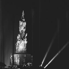 Bathing. (AM__CH) Tags: longexposure light people blackandwhite bw sculpture art film monument water fountain rain mxico analog umbrella canon mexico photography kodak grain squareformat puebla amchphotography artistsontumblr alejandromcamposherrera