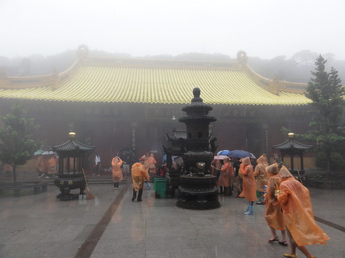 Heavy rain while visiting Huiji Monastery on top of the Fodingshan (mountain)